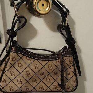 A beautiful mini Dooney and Bourke bag